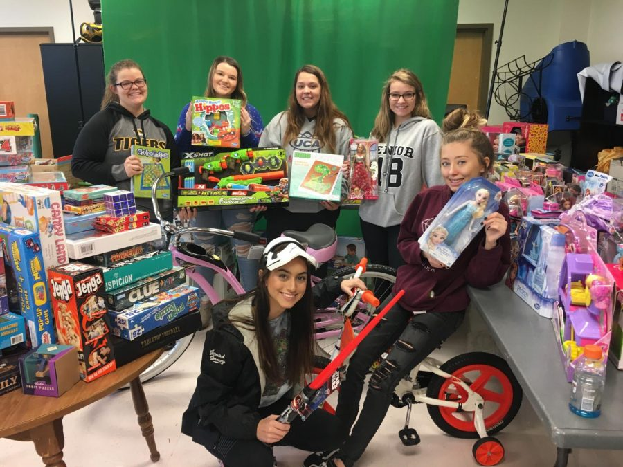 (From top left) Emily Krummrich, Taylor Turner, Kristina Johnson, Abby Roth, (from bottom left) Gaby Dorris and Morgan Cancienne all helped with the 2017 DECA Toy Drive.