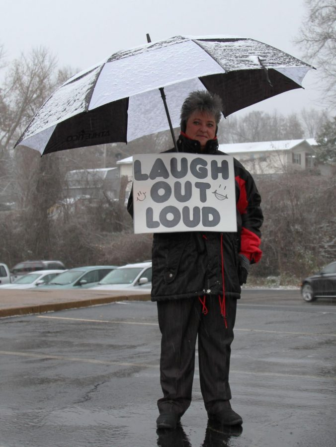 Mrs. Boehm resists the cold, snowy morning to welcome teachers and students.