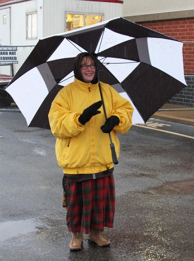 Teacher at Windsor High School, Mrs. Miller, stands out in the snow with a warm, welcoming smile.