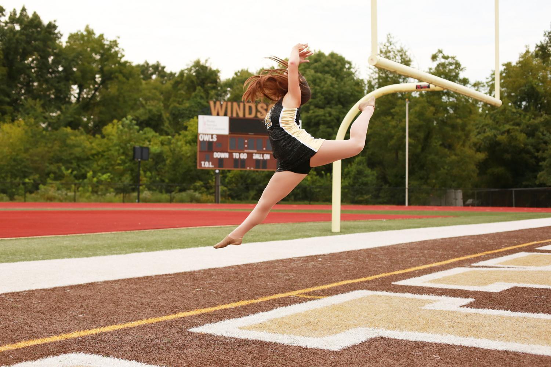 Captain Hannah Scott jumping for joy her senior year.