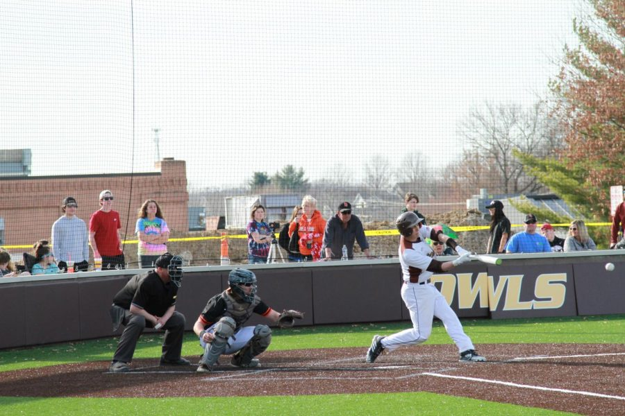 Connor Hartmann swings a little early on a curveball.